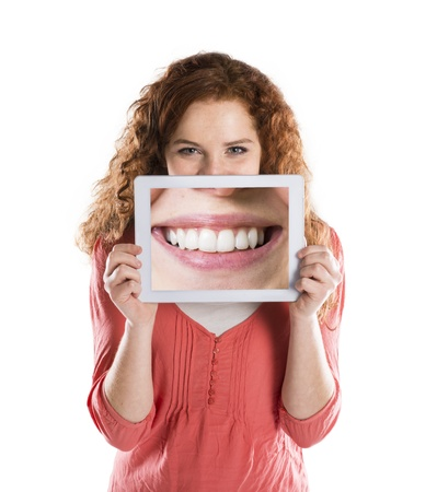 Funny studio portraits with tablet on isolated background photo