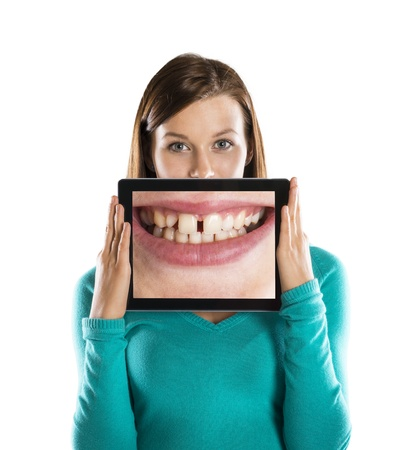 bad teeth: Funny studio portraits with tablet on isolated background