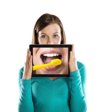 lachendes gesicht: Lustige Studioportr�ts mit Tablette auf wei�em Hintergrund Lizenzfreie Bilder