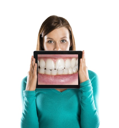 toothy smile: Funny studio portraits with tablet on isolated background