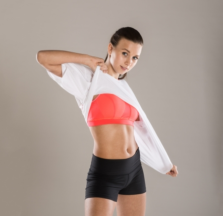 sporty: Beautiful young woman with perfect body in studio