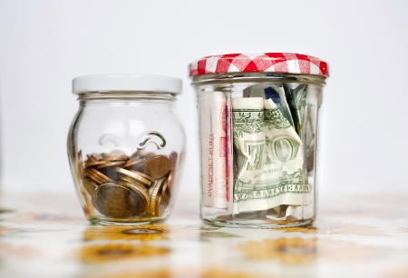 Money savings in the glass jars photo