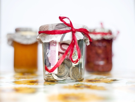 Money savings in the glass jar with preserves Stock Photo - 18608605