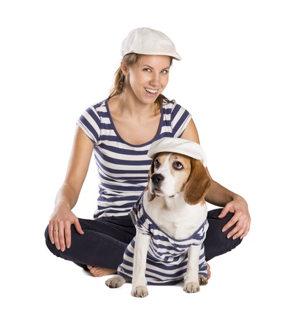 Dog with woman are posing in studio - isolated on white background Stock Photo