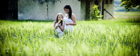 Mother and daughter are together in the park photo