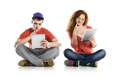 blank tablet: Beautiful young woman and man with tablet in studio