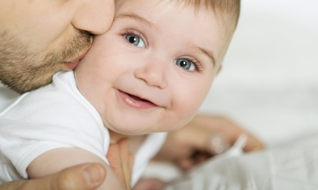 Young father is playing with his baby Stock Photo - 19157079