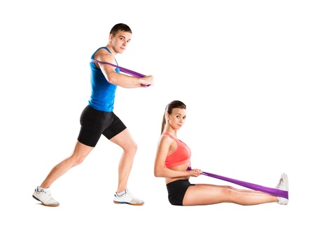 resistance: Young athlete doing exercises with a resistance band