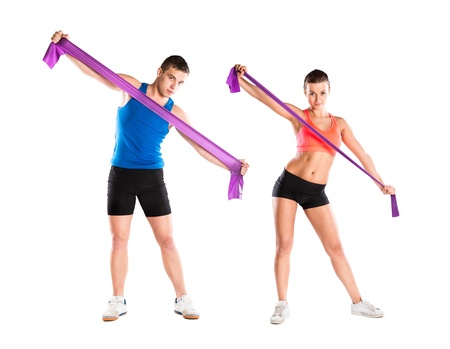 bands: Young athlete doing exercises with a resistance band