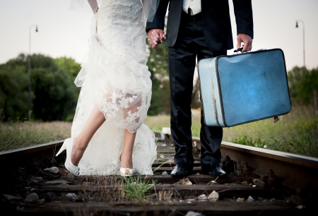 Bride and groom are walking outside together photo