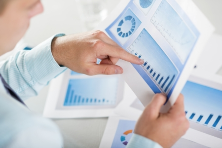 Business people reading business graphs and charts Stock Photo - 19363507