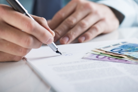 Businessman is signing a contract, business contract details Stock Photo - 19363519