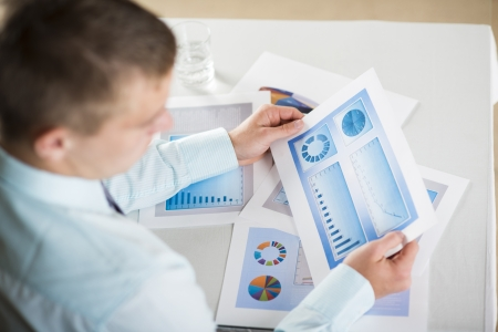 Business people reading business graphs and charts Stock Photo - 19363510