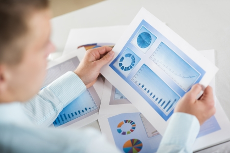 Business people reading business graphs and charts Stock Photo - 19363516