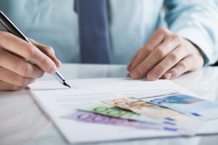 Businessman is signing a contract, business contract details Stock Photo - 19363524