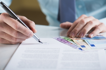 Businessman is signing a contract, business contract details Stock Photo - 19363538