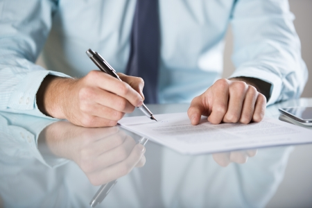 Businessman is signing a contract, business contract details Stock Photo - 19363537