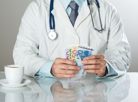 doctor with money: Closeup on medical doctor hands, taking money
