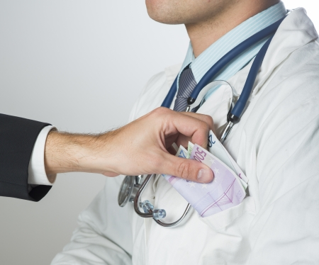 Closeup on medical doctor hands, taking money Stock Photo - 19384408