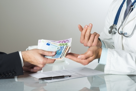 Closeup on medical doctor hands, taking money Stock Photo - 19384456