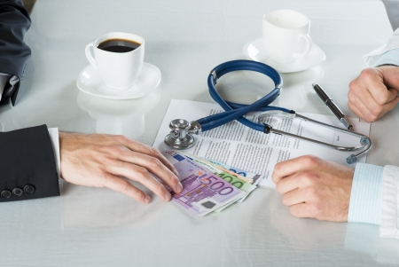 Closeup on medical doctor hands, taking money Stock Photo - 19371392