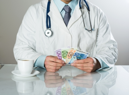 Closeup on medical doctor hands, taking money photo