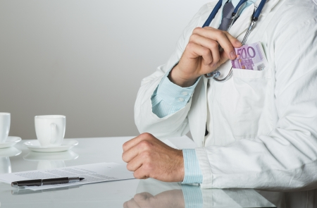 Closeup on medical doctor hands, taking money Stock Photo - 19384407