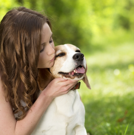 animal lover: Portrait of a woman with her beautiful dog outdoors Stock Photo