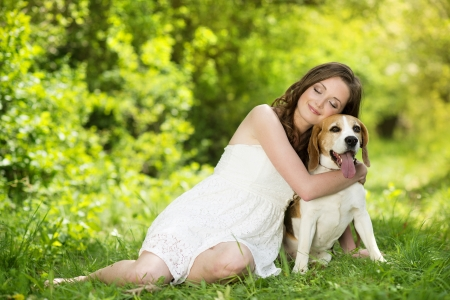Portrait of a woman with her beautiful dog outdoors Stock Photo