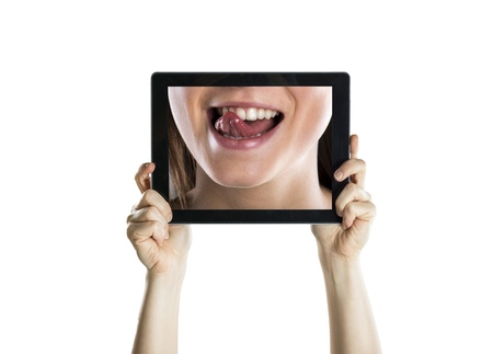 Dental closeup with tablet screen, isolated on white Stock Photo - 19452691