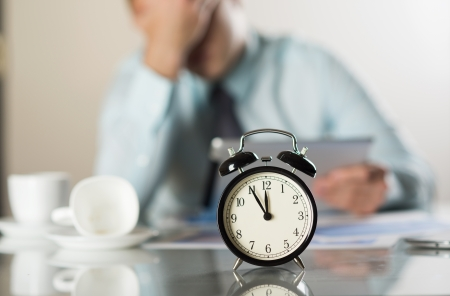 coffee hour: Businessman in office has problem with deadline Stock Photo