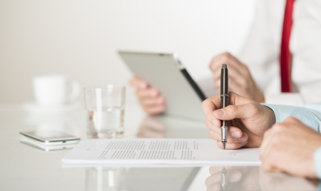 Businessman is signing a contract, business contract details photo