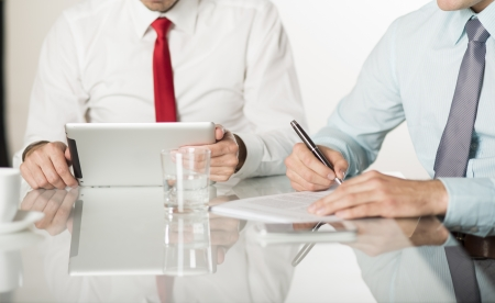 Businessman is signing a contract, business contract details Stock Photo - 19473688