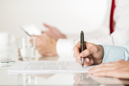 Businessman is signing a contract, business contract details Stock Photo - 19473671