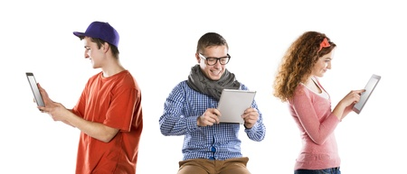 Beautiful young people with tablet in studio photo