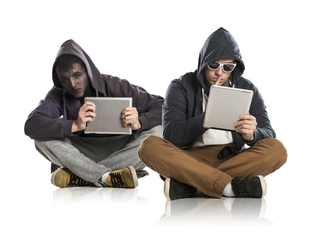 online safety: Concept of potentional internet danger with two man in disguise Stock Photo