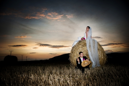hayloft: Bride and groom wedding portraits in nature
