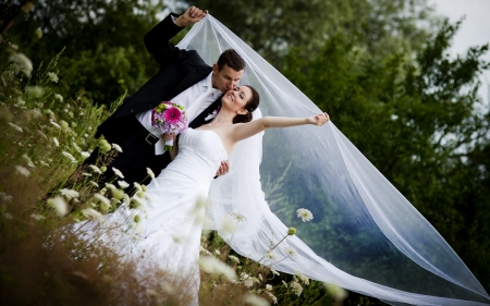 Bride and groom wedding portraits in nature photo