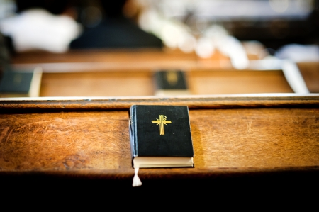 catholic church: Still photo of bible put on wooden desk in church Stock Photo