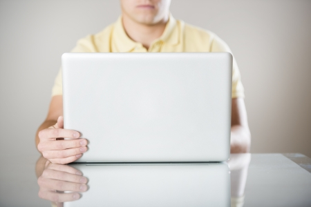 Detail of hands with laptop computer in office photo