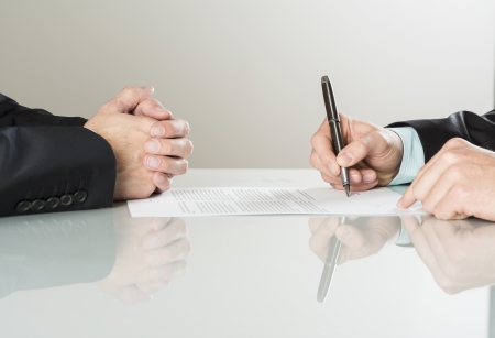agreement: Businessmen are signing a contract, business contract details