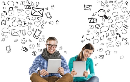 information medium: Beautiful young couple with tablets is using social media
