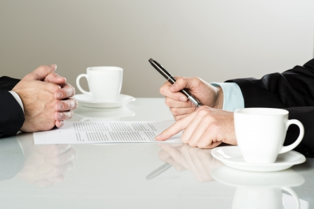 Businessmen are signing a contract, business contract details photo