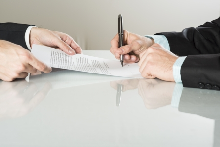 Businessmen are signing a contract, business contract details Stock Photo - 20208505