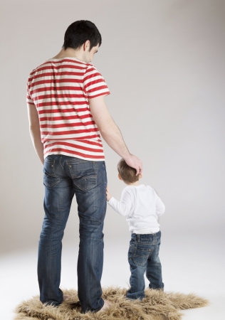 man s: Young father is playing with his son Stock Photo