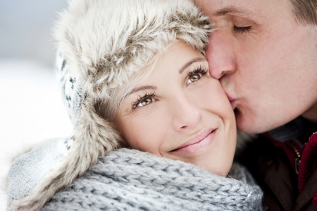 Happy couple is having romantic time in snowy countryside photo