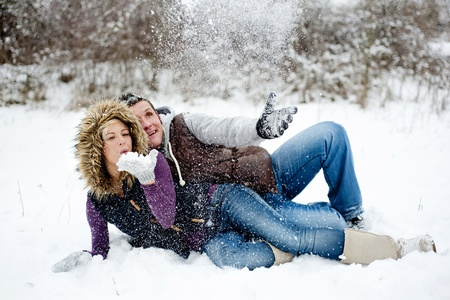 Happy couple is relaxing in snowy countryside photo