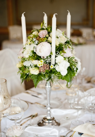 Beautiful floral wedding table decoration at wedding reception photo