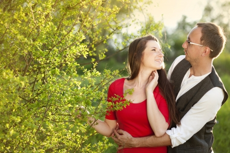 Happy couple is having romantic time in nature photo