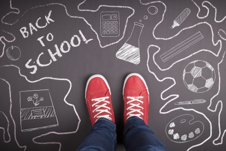 kids feet: Creative concept with Back to school theme Stock Photo